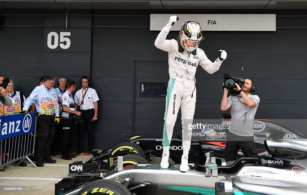 Mercedes AMG Petronas F1 Team's British driver Lewis Hamilton reacts after taking pole position in tomorrow's British Formula One Grand Prix during...