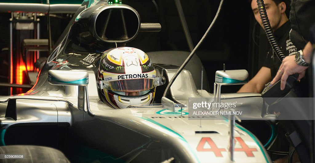 Mercedes AMG Petronas F1 Team's British driver Lewis Hamilton sits in his car during the first practice session of the Formula One Russian Grand Prix at the Sochi Autodrom circuit on April 29, 2016. / AFP / ALEXANDER