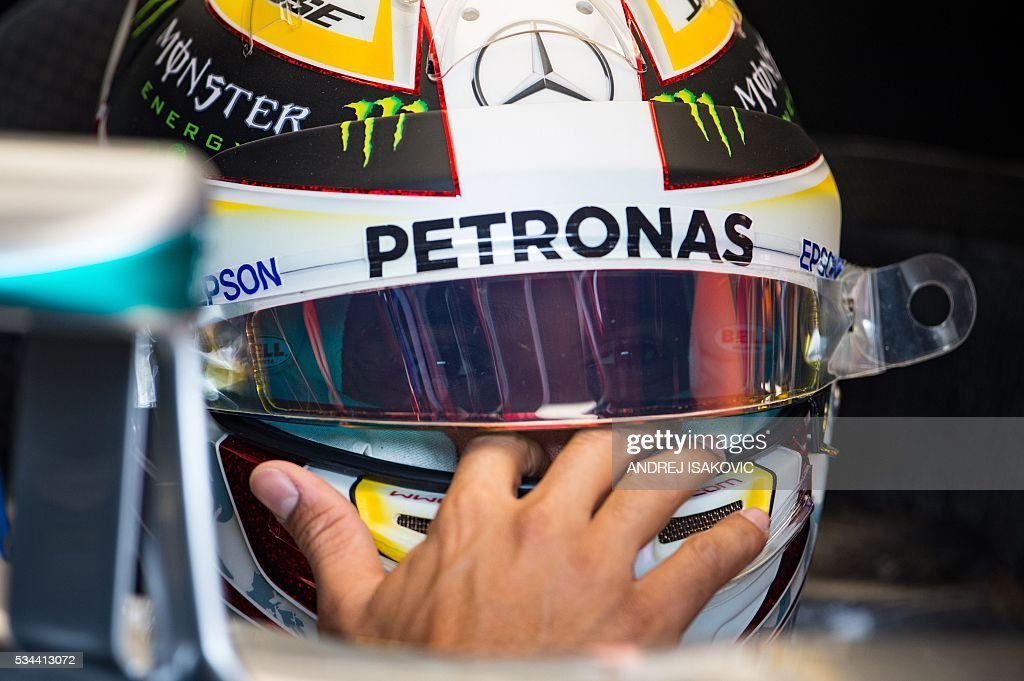Mercedes AMG Petronas F1 Team's British driver Lewis Hamilton sits in his car during the first practice session at the Monaco street circuit, on May 26, 2016 in Monaco, three days ahead of the Monaco Formula 1 Grand Prix. / AFP / ANDREJ