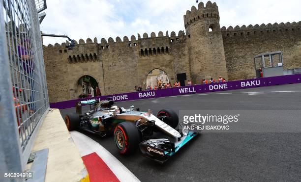 Mercedes AMG Petronas F1 Team's British driver Lewis Hamilton steers his car at the Baku City Circuit on June 17 2016 in Baku during the first...