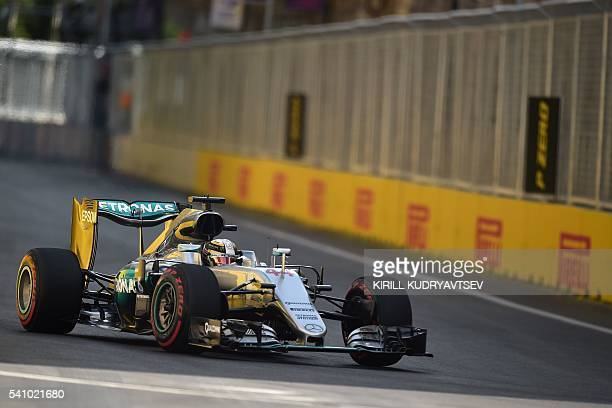 Mercedes AMG Petronas F1 Team's British driver Lewis Hamilton steers his car at the Baku City Circuit on June 18 2016 in Baku during the third...