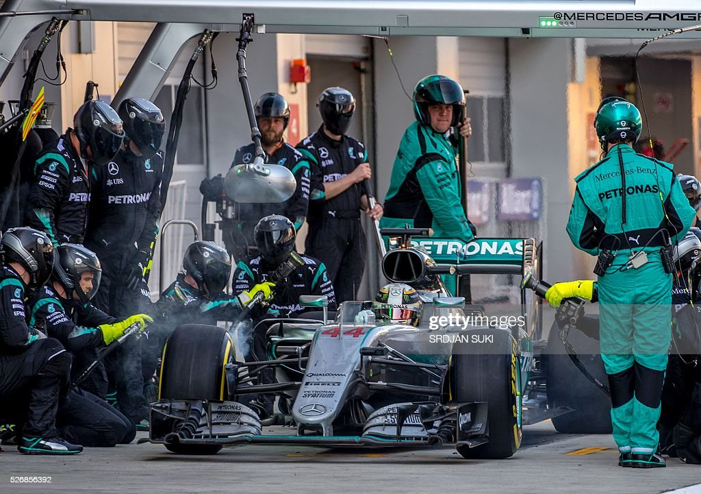 Mercedes AMG Petronas F1 Team's British driver Lewis Hamilton takes a pit stop during the Formula One Russian Grand Prix at the Sochi Autodrom circuit on May 1, 2016. / AFP / POOL / Srdjan Suki