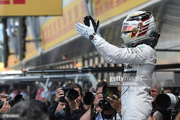 Mercedes AMG Petronas F1 Team's British driver Lewis Hamilton celebrates taking pole after the qualifying session at the Silverstone circuit in...