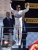 Mercedes AMG Petronas F1 Team's British driver Lewis Hamilton celebrates winning on the podium after the Italian Formula One Grand Prix at the...