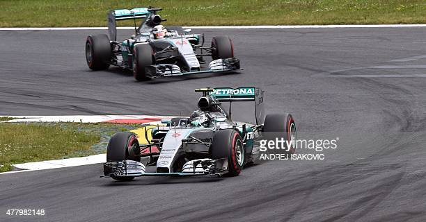 Mercedes AMG Petronas F1 Team's German driver Nico Rosberg and Mercedes AMG Petronas F1 Team's British driver Lewis Hamilton compete during the...