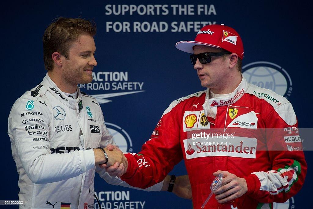 Mercedes AMG Petronas F1 Team's German driver Nico Rosberg and Ferrari's Finnish driver Kimi Raikkonen shake hands after qualifying at the Formula...