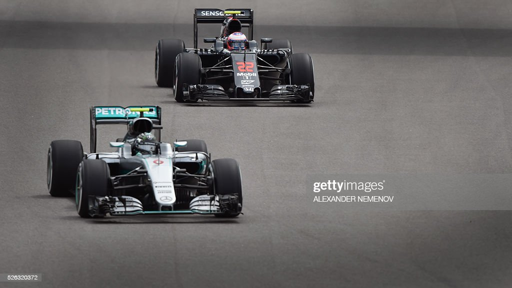 Mercedes AMG Petronas F1 Team's German driver Nico Rosberg (front) and McLaren Honda F1 Team's British driver Jenson Button steer their cars during the third practice session of the Formula One Russian Grand Prix at the Sochi Autodrom circuit on April 30, 2016. / AFP / ALEXANDER