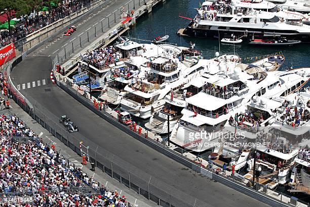 Mercedes AMG Petronas F1 Team's German driver Nico Rosberg and Scuderia Ferrari's German driver Sebastian Vettel drive at the Monaco street circuit...