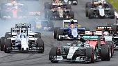 Mercedes AMG Petronas F1 Team's German driver Nico Rosberg and Williams Martini Racing's Brazilian driver Felipe Massa compete at the Red Bull Ring...