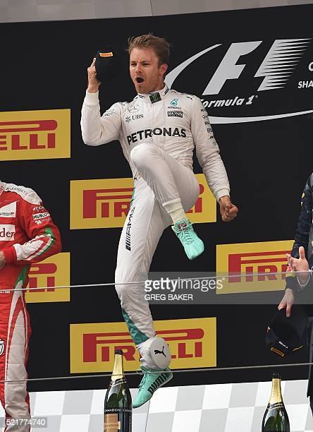 TOPSHOT Mercedes AMG Petronas F1 Team's German driver Nico Rosberg celebrates on the podium after winning the Formula One Chinese Grand Prix in...