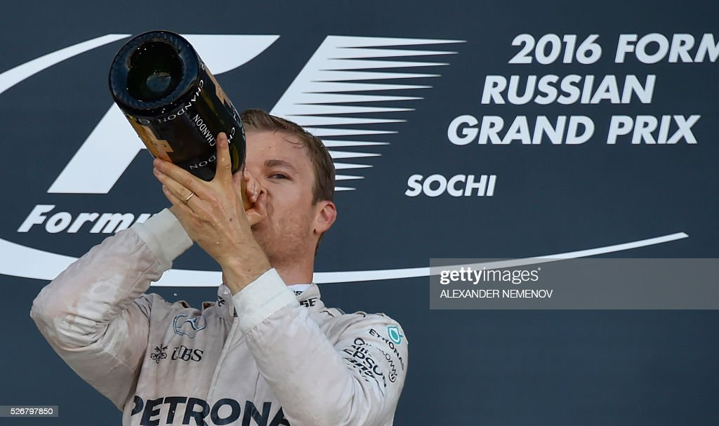 Mercedes AMG Petronas F1 Team's German driver Nico Rosberg celebrates on the podium after winning the Formula One Russian Grand Prix at the Sochi Autodrom circuit on May 1, 2016. / AFP / ALEXANDER