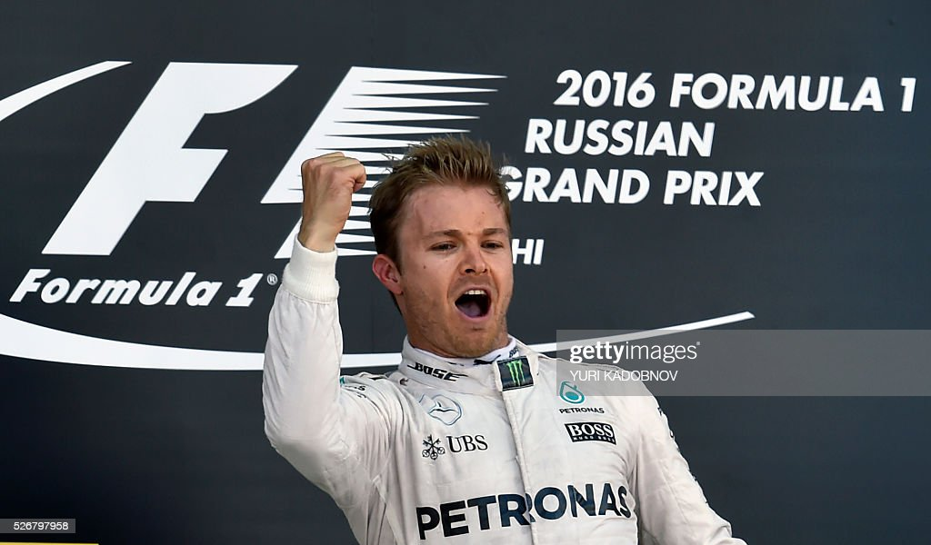 Mercedes AMG Petronas F1 Team's German driver Nico Rosberg celebrates on the podium after winning the Formula One Russian Grand Prix at the Sochi Autodrom circuit on May 1, 2016. / AFP / YURI