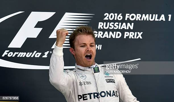TOPSHOT Mercedes AMG Petronas F1 Team's German driver Nico Rosberg celebrates on the podium after winning the Formula One Russian Grand Prix at the...
