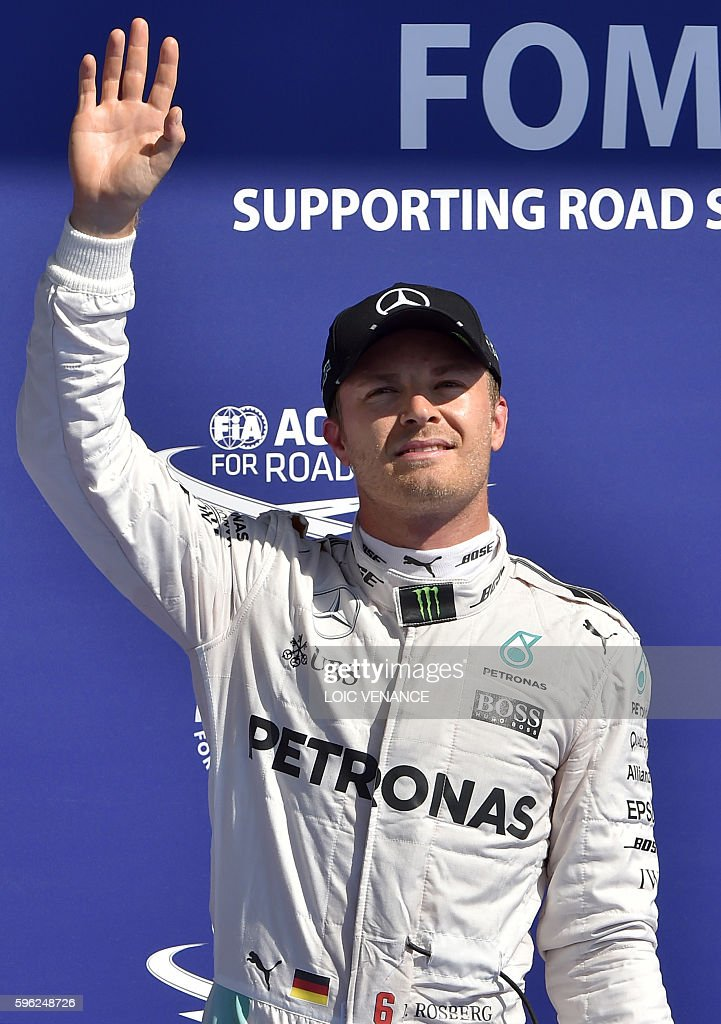 Mercedes AMG Petronas F1 Team's German driver Nico Rosberg celebrates after winning the pole position in the qualifying session at the...