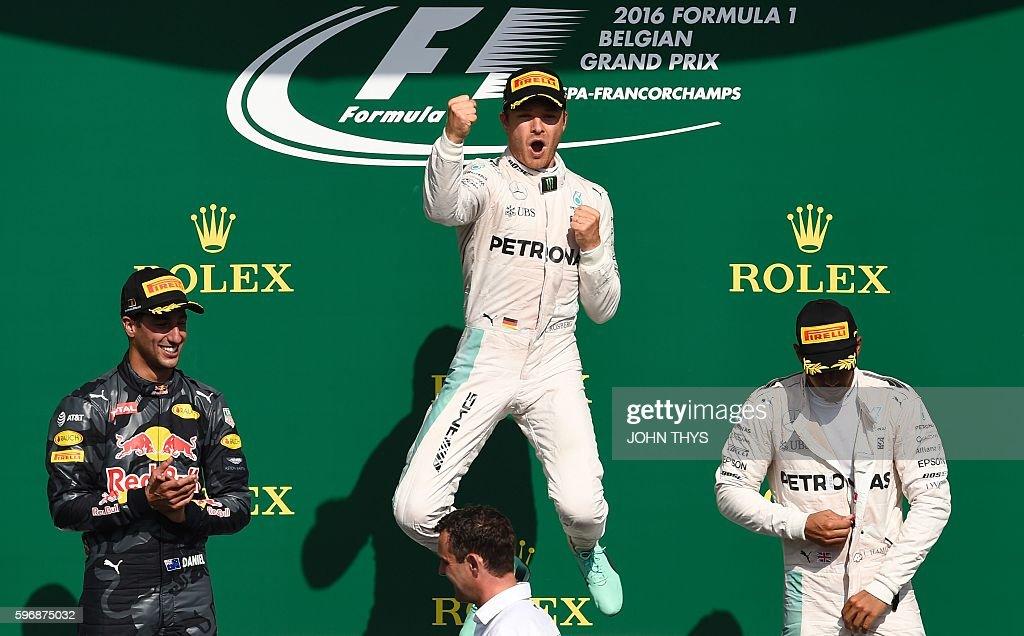 Mercedes AMG Petronas F1 Team's German driver Nico Rosberg celebrates winning next to second placed Red Bull Racing's Australian driver Daniel...