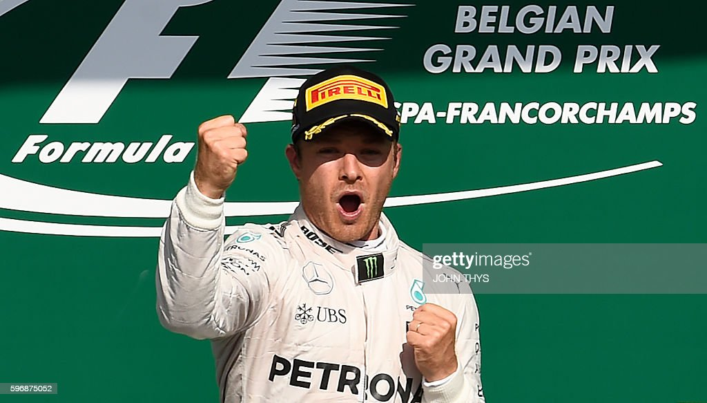 Mercedes AMG Petronas F1 Team's German driver Nico Rosberg celebrates winning the Belgian Formula One Grand Prix at the SpaFrancorchamps circuit in...