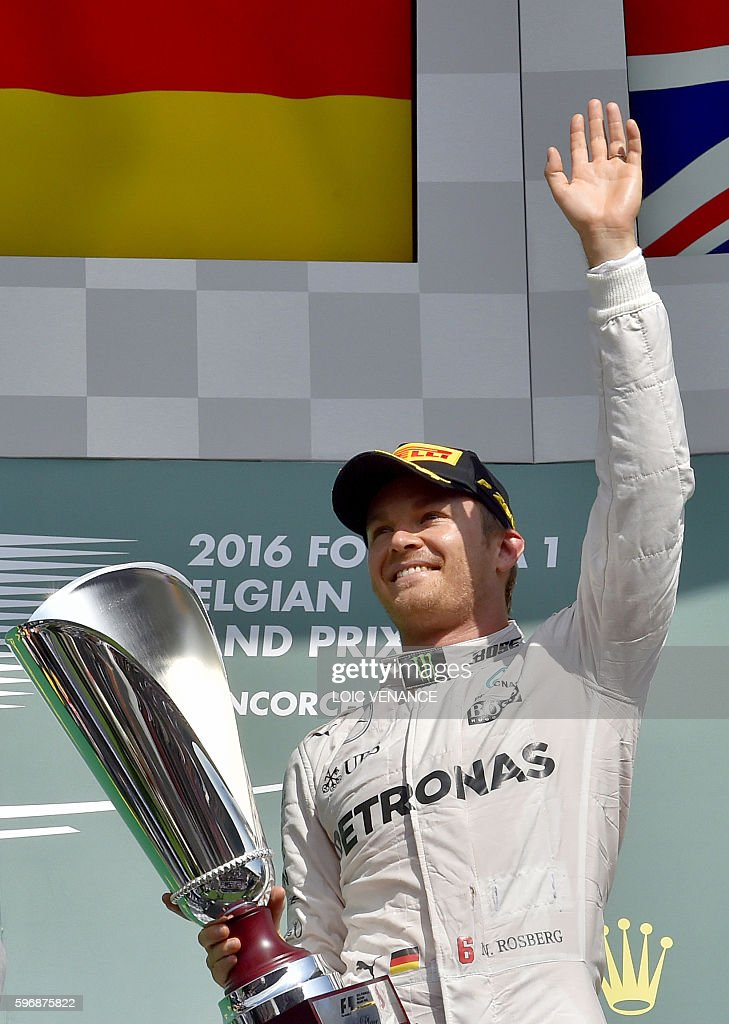 Mercedes AMG Petronas F1 Team's German driver Nico Rosberg celebrates with the trophy on the podium after winning the Belgian Formula One Grand Prix...