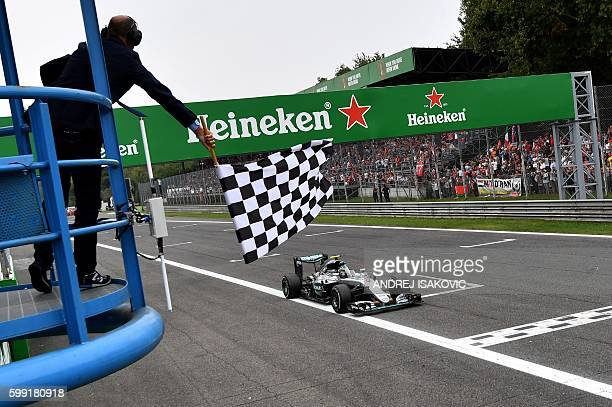 Mercedes AMG Petronas F1 Team's German driver Nico Rosberg crosses the finish line after winning the Italian Formula One Grand Prix at the Autodromo...