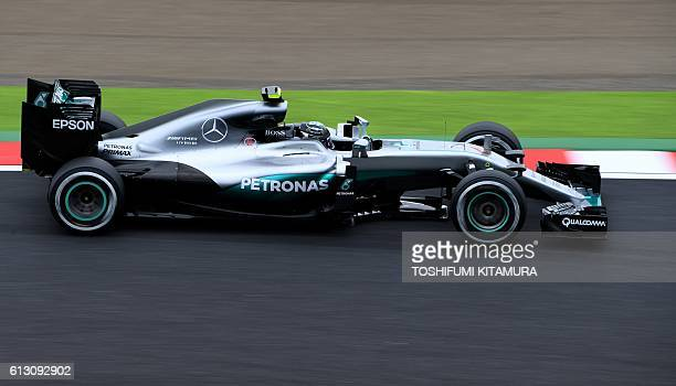 Mercedes AMG Petronas F1 Team's German driver Nico Rosberg drives his car during the second free practice session at the Formula One Japanese Grand...