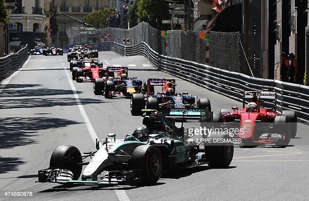 Mercedes AMG Petronas F1 Team's German driver Nico Rosberg drives in second place followed by Scuderia Ferrari's German driver Sebastian Vettel as...