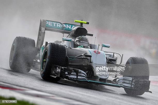 Mercedes AMG Petronas F1 Team's German driver Nico Rosberg drives during the qualifying session ahead of the Formula One Hungarian Grand Prix at the...