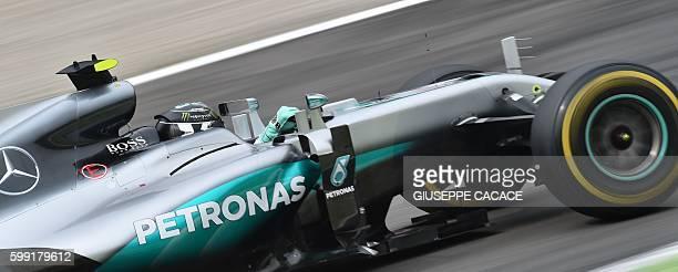 TOPSHOT Mercedes AMG Petronas F1 Team's German driver Nico Rosberg drives during the Italian Formula One Grand Prix at the Autodromo Nazionale...