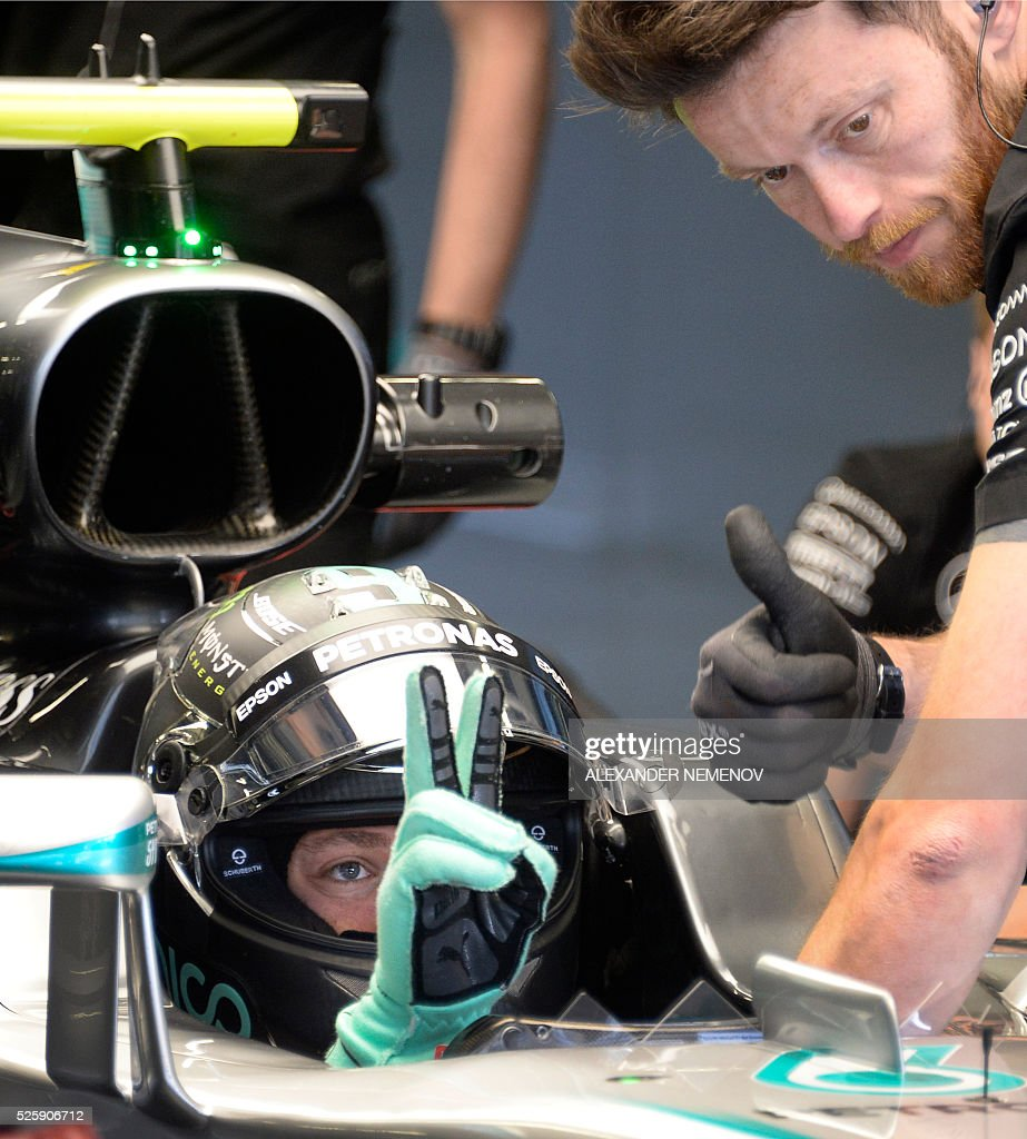 Mercedes AMG Petronas F1 Team's German driver Nico Rosberg gestures as he sits in his car during the first practice session of the Formula One Russian Grand Prix at the Sochi Autodrom circuit on April 29, 2016. / AFP / ALEXANDER