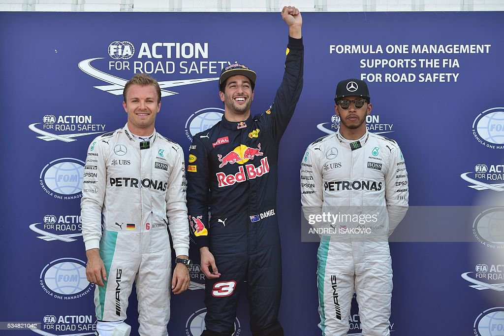 Mercedes AMG Petronas F1 Team's German driver Nico Rosberg, Infiniti Red Bull Racing's Australian driver Daniel Ricciardo and Mercedes AMG Petronas F1 Team's British driver Lewis Hamilton celebrate in the parc ferme during the qualifying session at the at the Monaco street circuit, on May 28, 2016 in Monaco, one day ahead of the Monaco Formula 1 Grand Prix. / AFP / ANDREJ