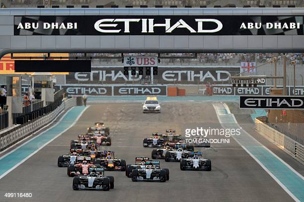 Mercedes AMG Petronas F1 Team's German driver Nico Rosberg leads after the start of the of the Abu Dhabi Formula One Grand Prix at the Yas Marina...