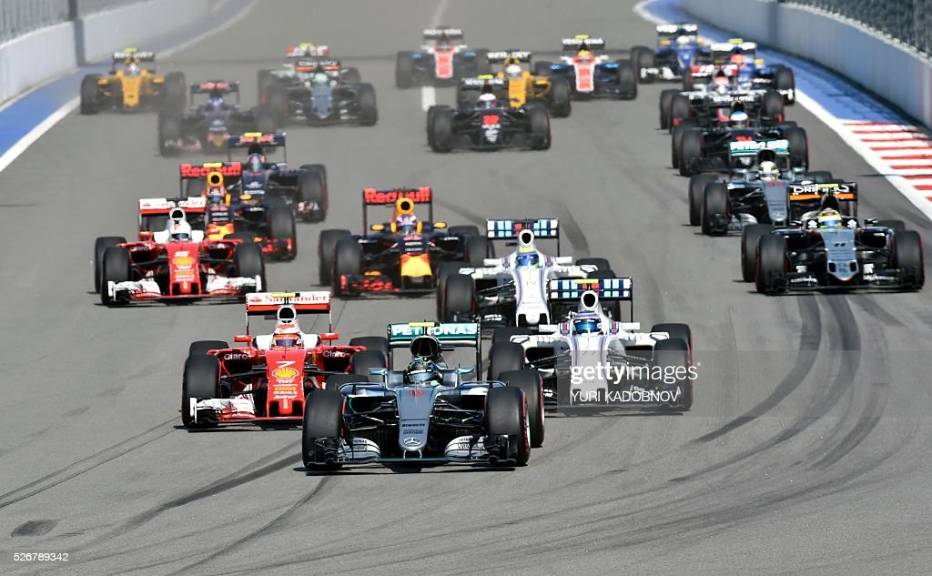 Mercedes AMG Petronas F1 Team's German driver Nico Rosberg leads Scuderia Ferrari's Finnish driver Kimi Raikkonen and Williams Martini Racing's Finnish driver Valtteri Bottas during the Formula One Russian Grand Prix at the Sochi Autodrom circuit on May 1, 2016. / AFP / YURI