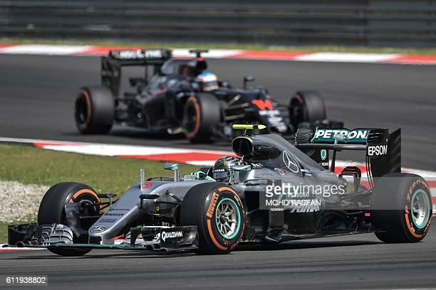 Mercedes AMG Petronas F1 Team's German driver Nico Rosberg leads McLaren Honda's Spanish driver Fernando Alonso during the Formula One Malaysian...