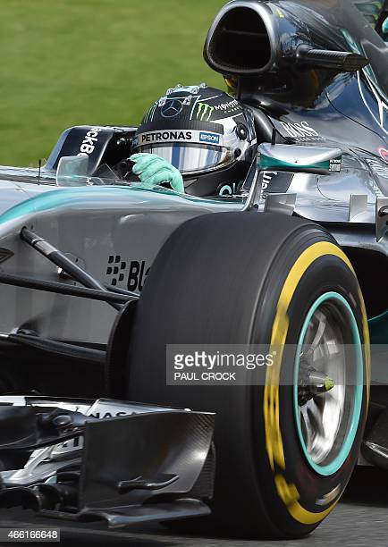 Mercedes AMG Petronas F1 Team's German driver Nico Rosberg powers through a corner during the third practice session for the Formula One Australian...