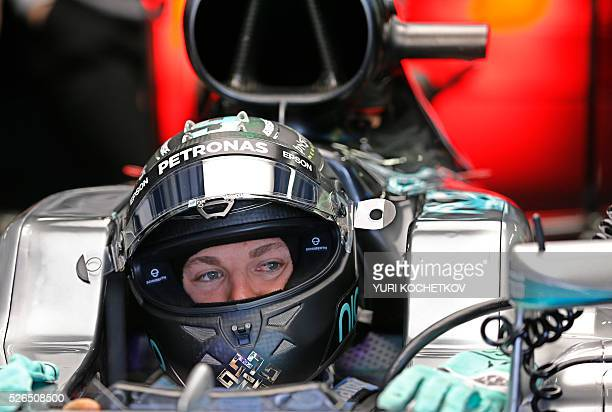 Mercedes AMG Petronas F1 Team's German driver Nico Rosberg sits in his car during the qualifying session of the Formula One Russian Grand Prix at the...