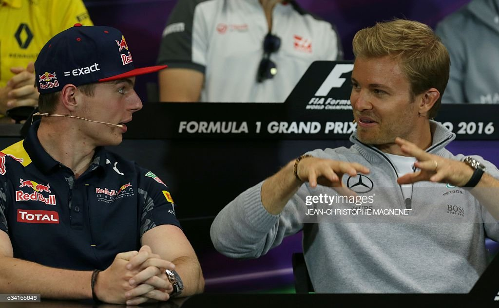 Mercedes AMG Petronas F1 Team's German driver Nico Rosberg (R) speaks with Infiniti Red Bull racing's Belgian-Dutch driver Max Verstappen during a press conference at the Monaco street circuit in Monte-Carlo on May 25, 2016, four days ahead of the Monaco Formula One Grand Prix. / AFP / Jean-Christophe MAGNENET
