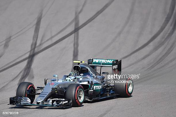 Mercedes AMG Petronas F1 Team's German driver Nico Rosberg steers his car during the Formula One Russian Grand Prix at the Sochi Autodrom circuit on...