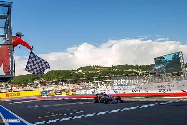 TOPSHOT Mercedes AMG Petronas F1 Team's German driver Nico Rosberg wins the Formula One Russian Grand Prix at the Sochi Autodrom circuit on May 1...