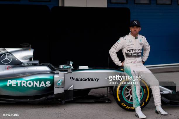 Mercedes AMG Petronas F1's British driver Lewis Hamilton poses during the unveiling of the team's racing car during the Formula One test days at...