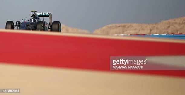 Mercedes AMG Petronas German driver Nico Rosberg steers his car during the third practice session of the Formula One Bahrain Grand Prix at Bahrain's...
