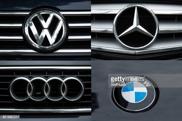 A VW Mercedes Audi and BMW badges on July 24 2017 in Berlin Germany Germany's biggest car companies VW Audi Porsche BMW and Daimler are being...
