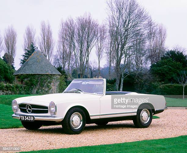 Mercedes Benz 230 SL on gravel drive by Palace House 2000