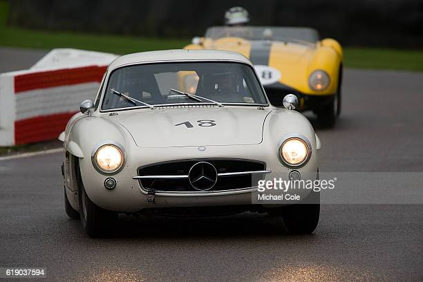 Mercedes Benz 300SL 'Gullwing' entered by Hans Kleissl and driven by Jochen Mass on the chicane in the wet during the Freddie March Memorial Trophy...