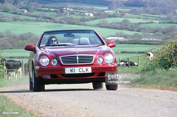Mercedes Benz clk 320 cabriolet driving on country road 2000