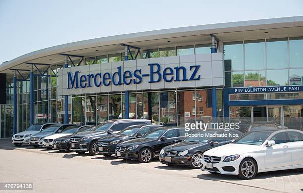 Mercedes Benz dealer in a city outdoor display of the German luxury car