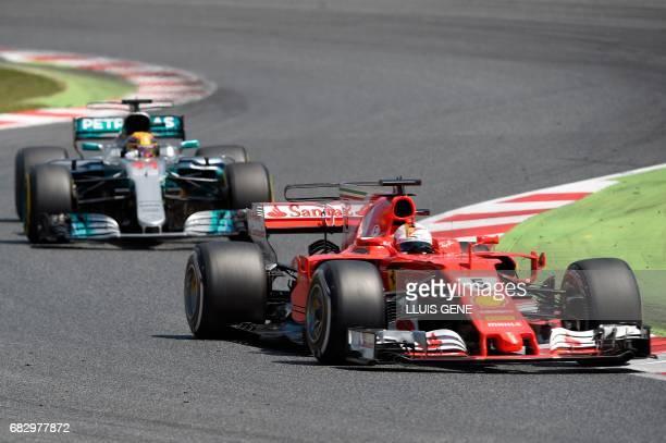 Mercedes' British driver Lewis Hamilton and Ferrari's German driver Sebastian Vettel race at the Circuit de Catalunya on May 14 2017 in Montmelo on...