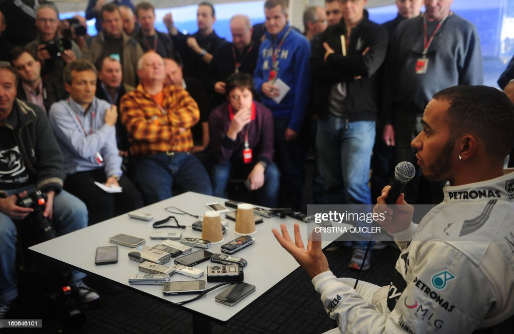 Mercedes' British driver Lewis Hamilton (R) answers to journalists during a press conference as part of a training session at the Jerez de la Frontera racetrack on February 4, 2013.