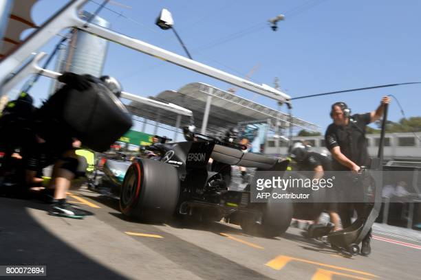 TOPSHOT Mercedes' British driver Lewis Hamilton attends the first practice session of the Formula One Azerbaijan Grand Prix at the Baku City Circuit...