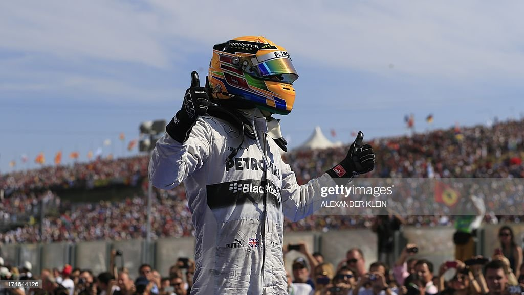 Mercedes' British driver Lewis Hamilton celebrates in the parc ferme at the Hungaroring circuit in Budapest on July 28, 2013 during the Hungarian Formula One Grand Prix. AFP PHOTO / ALEXANDER KLEIN