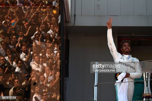 TOPSHOT Mercedes' British driver Lewis Hamilton celebrates on the podium after winning the Spanish Formula One Grand Prix on May 14 2017 at the...