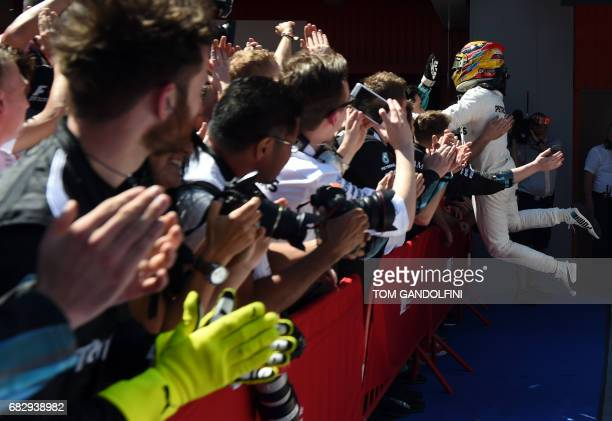 TOPSHOT Mercedes' British driver Lewis Hamilton celebrates winning at the Circuit de Catalunya on May 14 2017 in Montmelo on the outskirts of...
