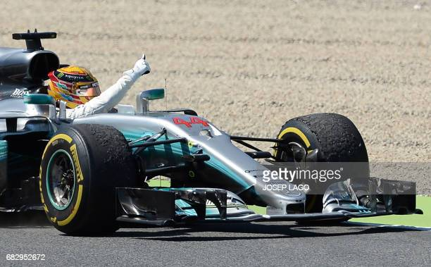 Mercedes' British driver Lewis Hamilton celebrates winning the Spanish Formula One Grand Prix on May 14 2017 at the Circuit de Catalunya in Montmelo...